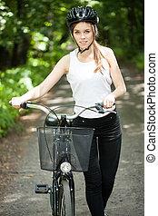Woman in helmet on bicycle trip