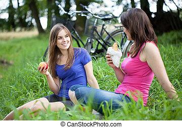 Breakfast on a green glade - Girls breakfast on a green...