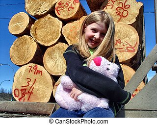 Sitting with stuffy and logs - sitting on the back of a...