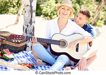 Adult couple and guitar