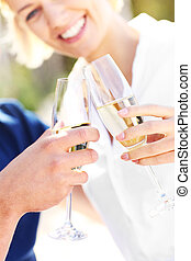 Glasses of champagne at the beach