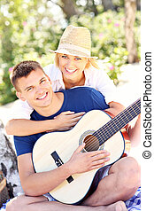 Happy couple and guitar