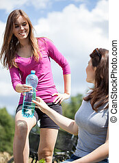 Girls drink water on bicycle trip