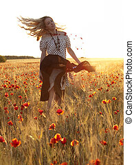 Blonde walking in poppy field - Beautiful blonde lady...