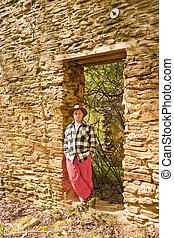 Hispanic Man in Rock Doorway