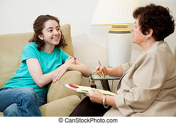 Teen Interview - Woman interviewing a teen girl for college...