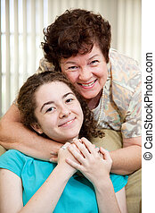 Mom Loves Teen Daughter - Portrait of a mother giving her...