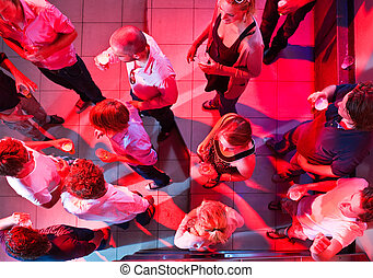 Party viewed from above - A party on the dancefloor of a...