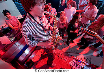 Performance in a nightclub - A performance of a saxophonist...