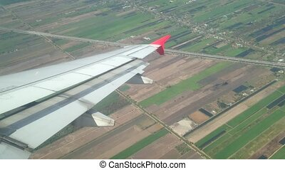 Window view of landing plane. - Aerial scene of a plan...