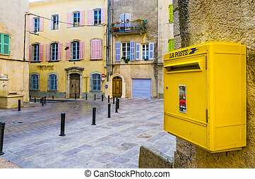 French Postbox - A yellow classical postbox in the little...