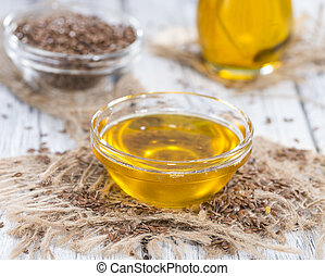 Linseed Oil - Small portion of golden Linseed Oil with some...