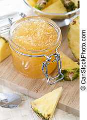 Homemade Pineapple Jam in a small glass with fresh fruit...