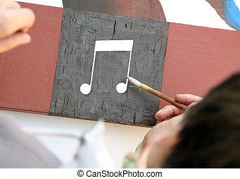 Painting Music with paint on a plate
