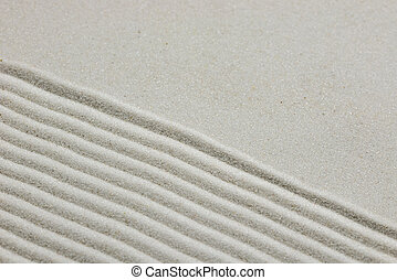 Zen background of raked sand with diagonal parallel lines on...