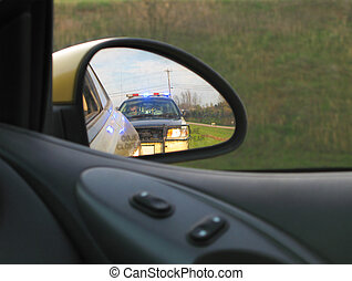 Stopped by Police - Police car is reflected in rear view...