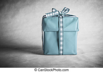 Blue Gift Box Tied with Bow - A solitary, vintage styled...
