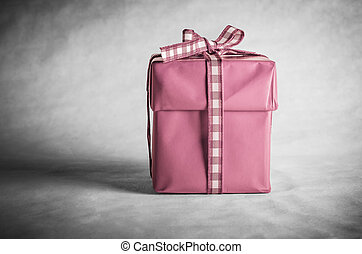 Pink Gift Box Tied with Bow - A solitary gift box with lid,...