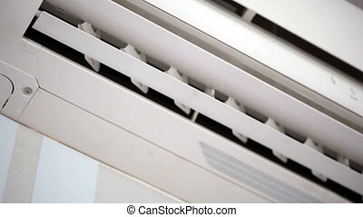 Air-conditioner close-up - White air-conditioner close-up...