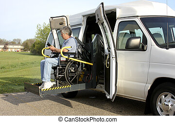wheelchair lift - handicapped man using a wheelchair lift to...