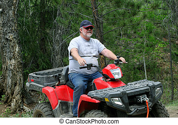 ATV - Bearded middle aged caucasian man with baseball cap...