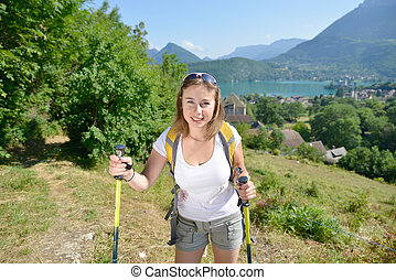 pretty young woman is hiking in mountains - pretty young...