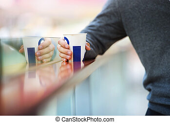 Man in shopping mall drinking - Handsome young man in...
