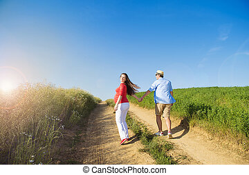 Pregnant couple with blue sky - Portrait of young pregnant...