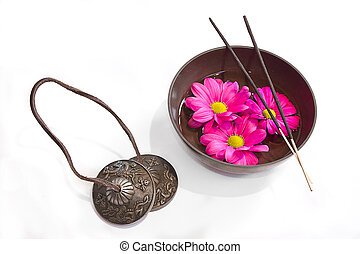 Oriental health treatment: tingsha, tibetan bowl and incense...