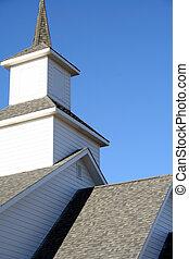 Church steeple against a blue Colorado sky.