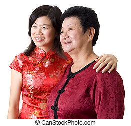 Mother & Daughter. - Asian Chinese Mother & Daughter looking...