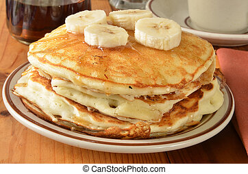 Home cooked pancakes with bananas - A stack of home cooked...
