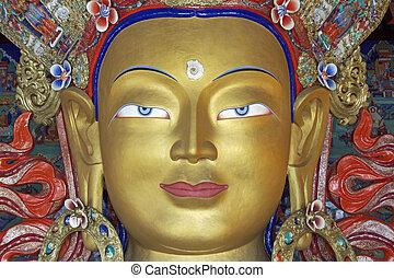 Golden Buddha - Head of a golden Buddha inside a temple at...