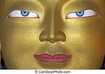 Face of Enlightenment - Eyes of a golden Buddha inside a...
