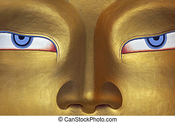 Eyes of a Buddha - Eyes of a golden Buddha inside a temple...