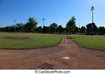 Ball Field and Shadows - A wide-angle shot of an unoccupied...