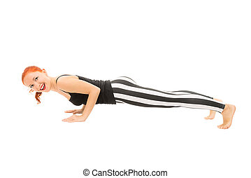 Chaturanga dandasana - Young girl demonstrating advanced...