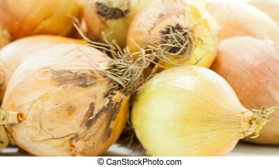 Raw Onion - Raw onion rotating on the white table with white...