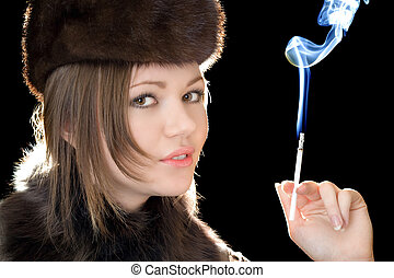 Portrait of the beautiful woman with a cigarette