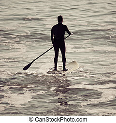 Paddle Board - Silhouette of a man paddle boarding