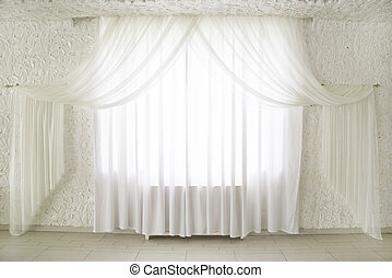 curtains on windows - white draped curtains on the window in...