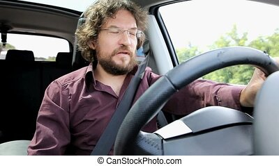 Man driving bored about traffic - Unhappy man driving in...