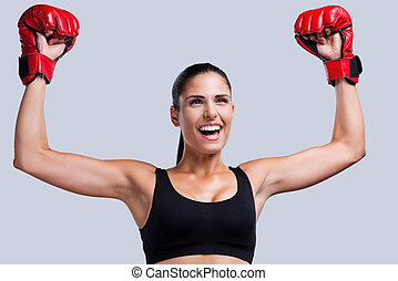 I am a winner Happy young sporty woman in boxing gloves...