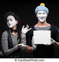 funny mimes - couple funny mimes holding sign