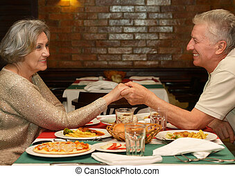 Dinner at restaurant - Senior couple having a dinner at...