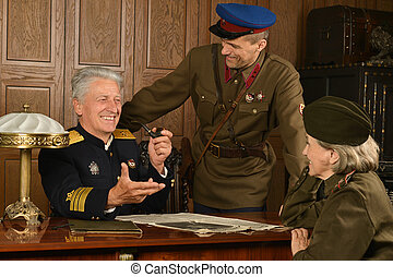 Military mature general on the table with soldiers