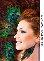 Peacock - Red haired girl with peacock feather earings