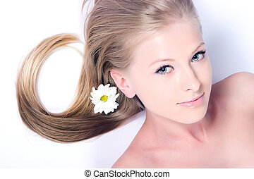 Camomile flower and girl - Beautiful blonde girl with...