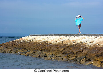 Loneliness - Brunette girl in white hat standing alone on...