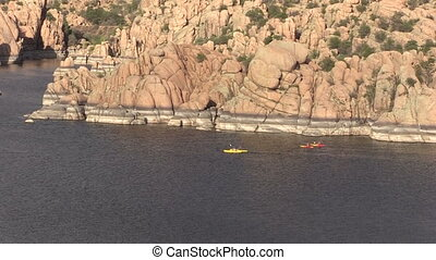 Kayaking on Watson Lake - kayakers out enjoying scenic...